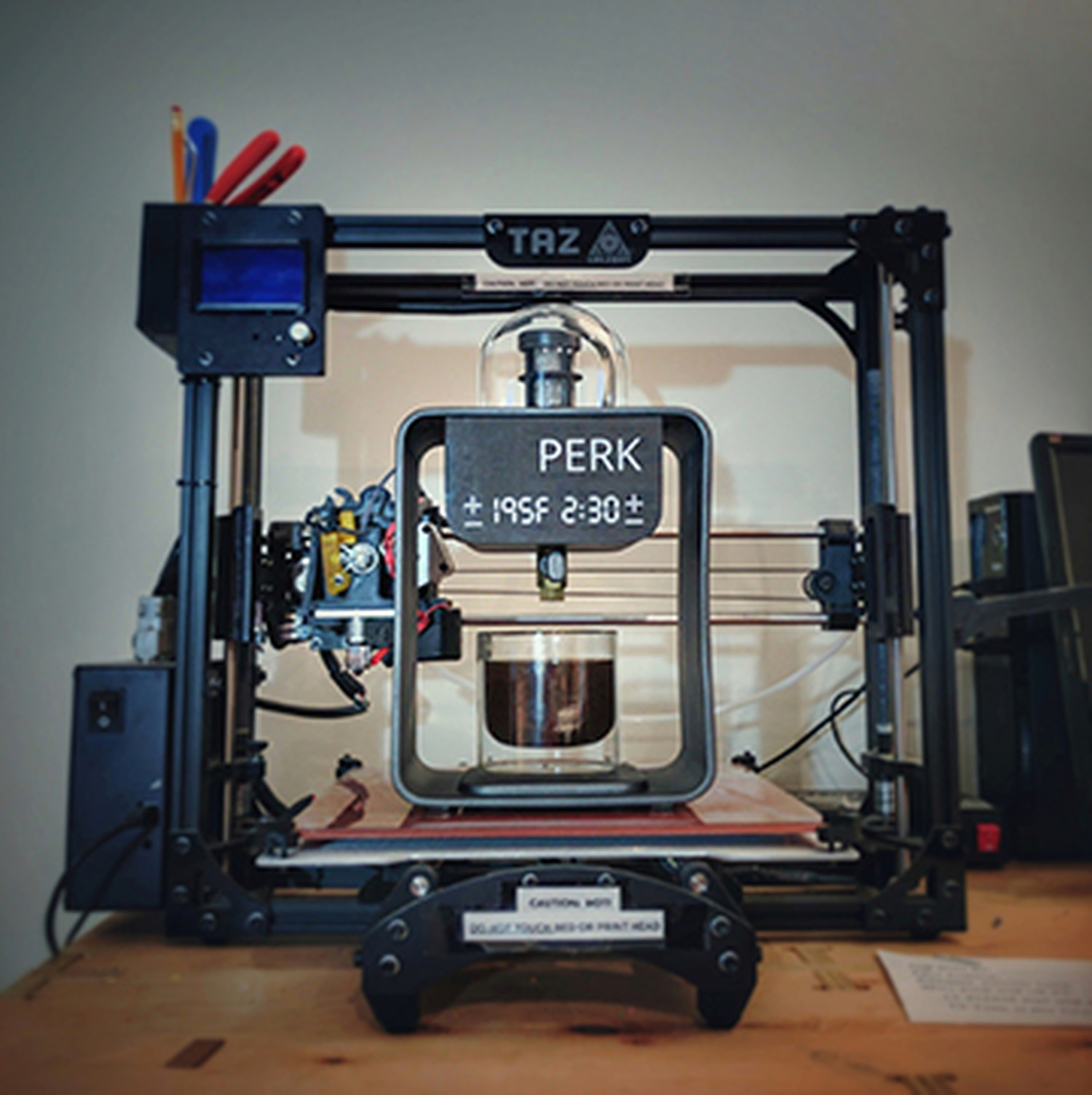 PERK becomes self-aware on the lap of a 3D printer. It percolates quietly as it contemplates Asimov's three laws of robotics.