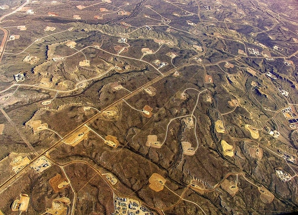 In areas where hydraulic fracturing is heavy, like this part of Wyoming, a dense web of roads, pipelines and well pads turn continuous forests and grasslands into fragmented islands. Community activism might be a way to curb the adverse impacts.