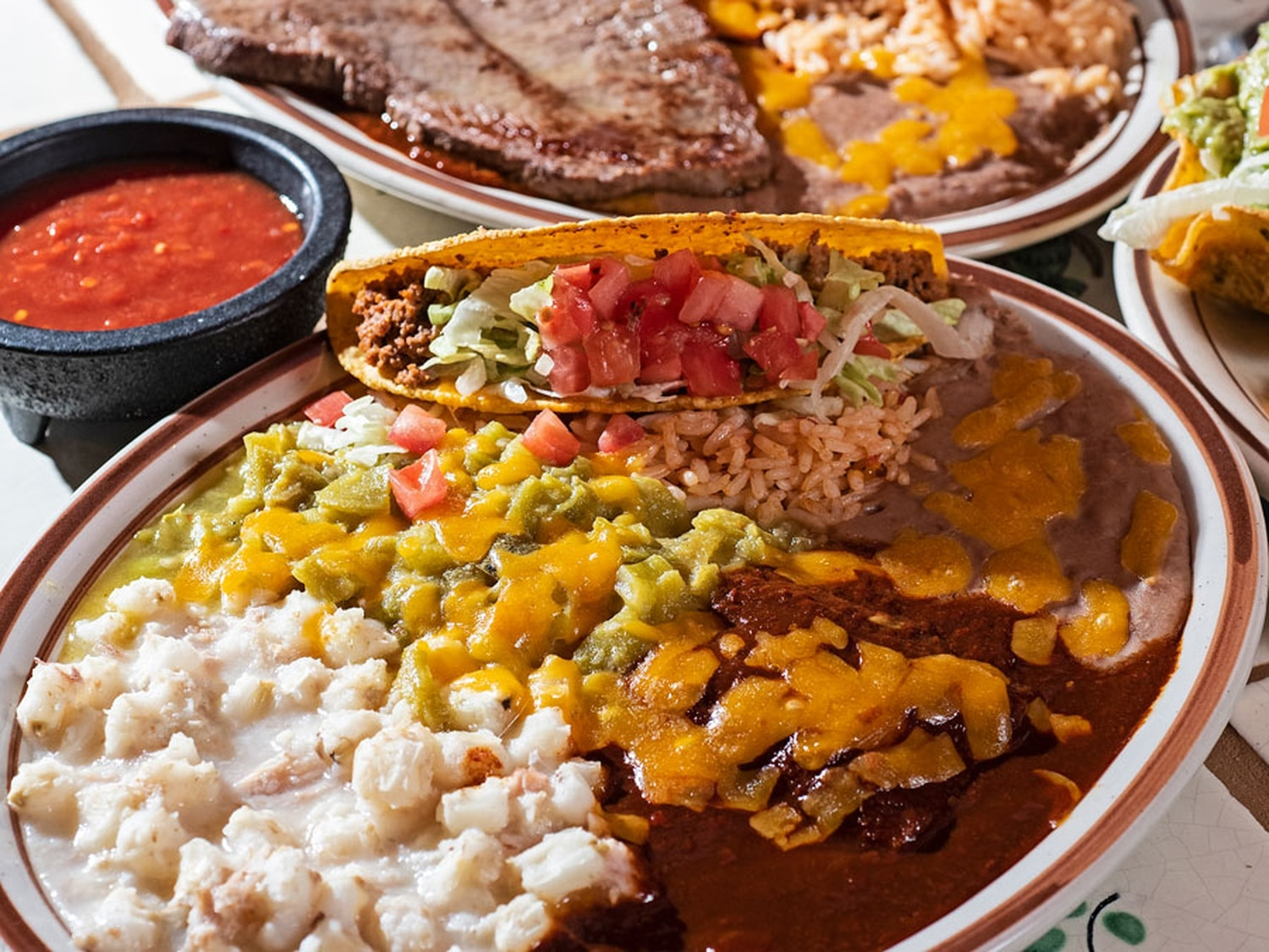 Combo plate with beef taco, cheese enchilada, rice, beans and posole