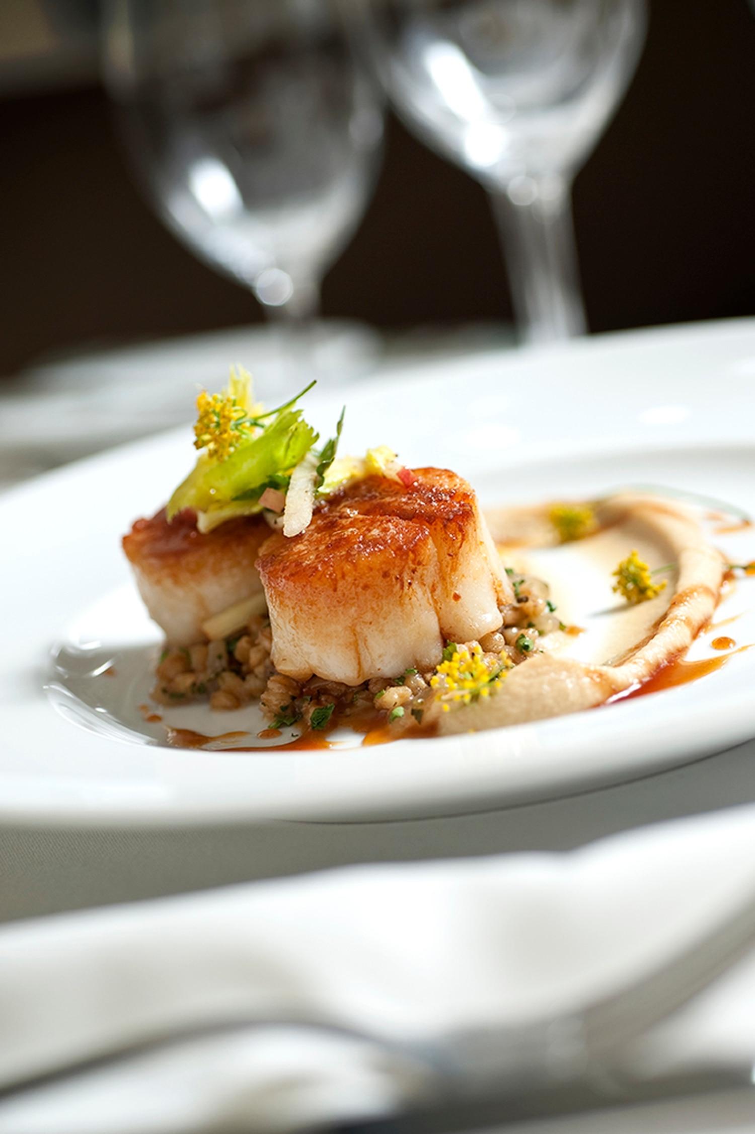 Seared diver scallops; caramelized onion and foie gras farotto; cider reduction