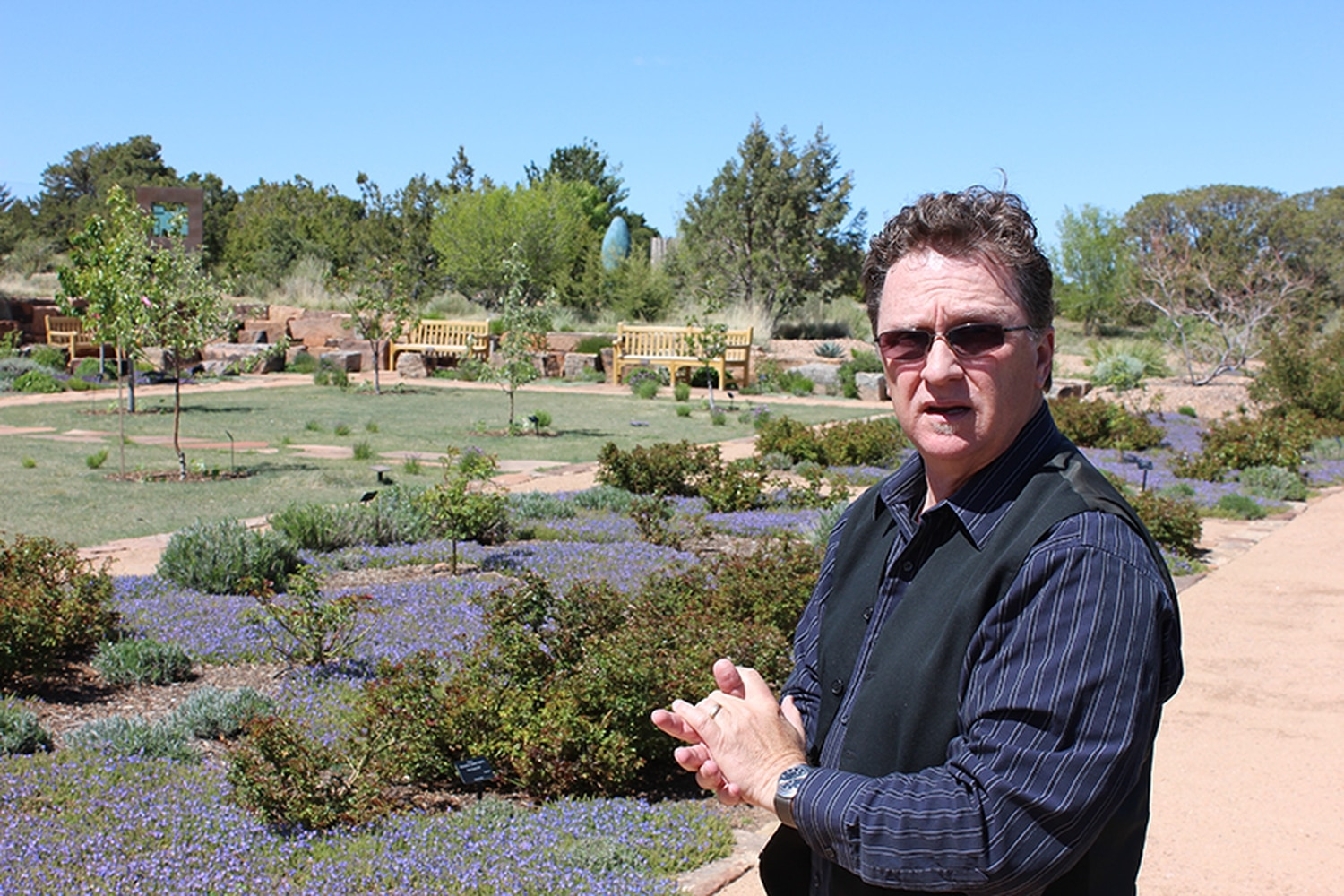 CEO Clayton Bass shows off the Santa Fe Botanical Garden on Museum Hill.