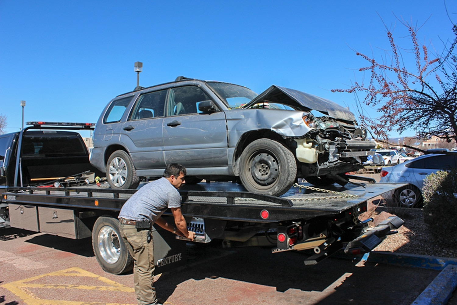 Police say the woman driving this Subaru backed into two cars before driving into Jambo. Matt Grubs