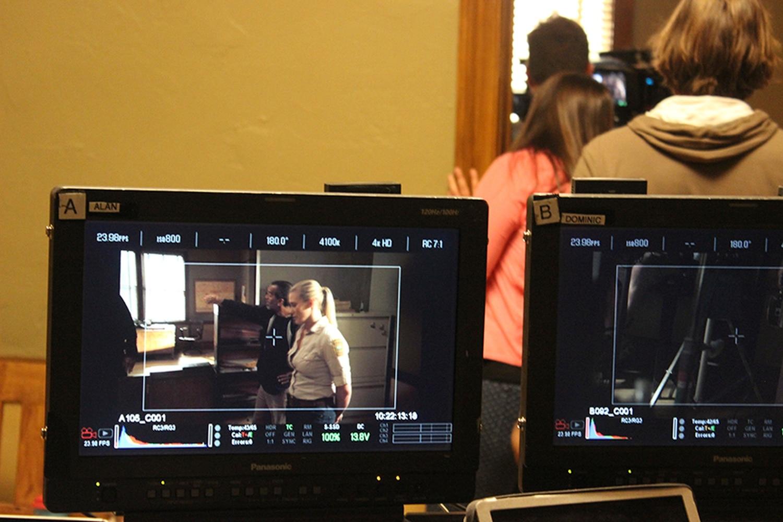What director J Michael Muro sees; the monitor captures Katee Sackhoff between shots.