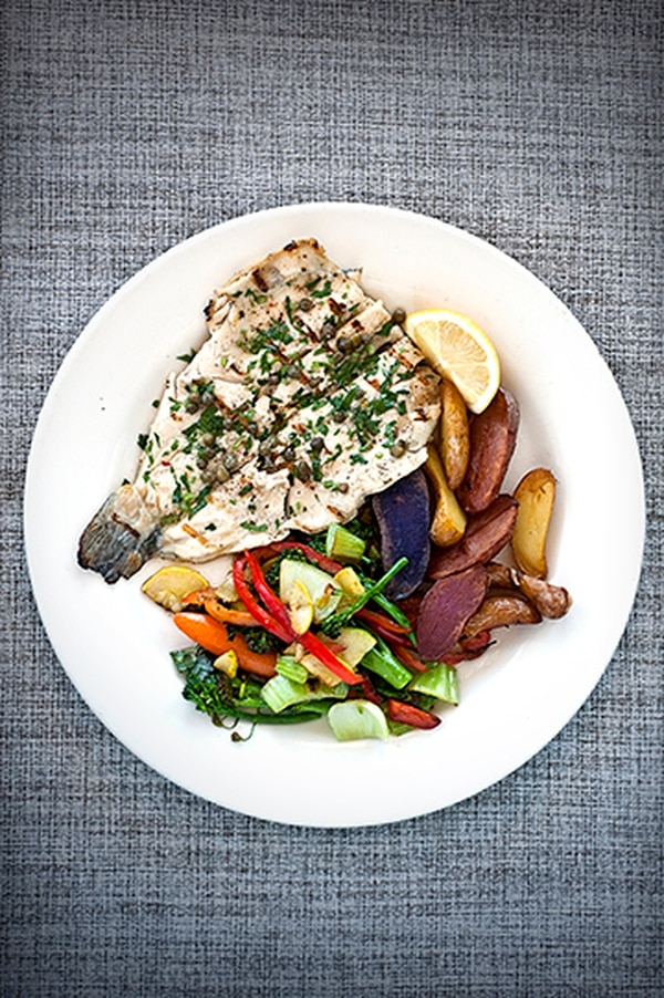 Grilled trout with roasted potatoes, sauteed seasonal veggies and lemon caper butter