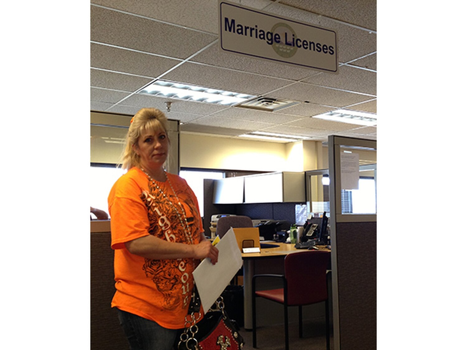 """Under a new law, Jeanne Marsh can't marry her incarcerated fiancé until his expected release in September 2015 because he can't appear at the clerk's office in person. """"It's not like he can ask the warden for an hour off,"""" she says."""