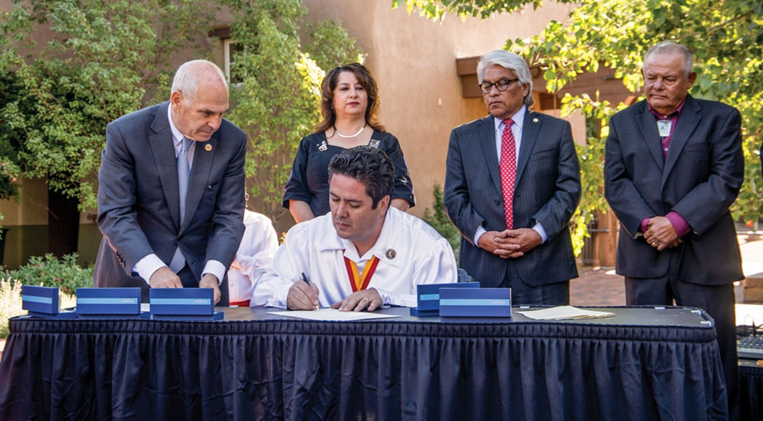 Webber watches as local Hispanic and Pueblo leaders sign a proclamation effectively ending the Entrada.