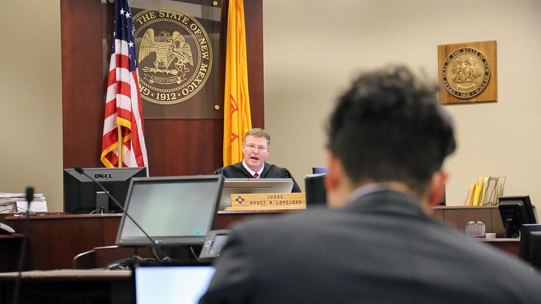 Judge Brett Loveless questions a prosecutor at a hearing on Nov. 7.