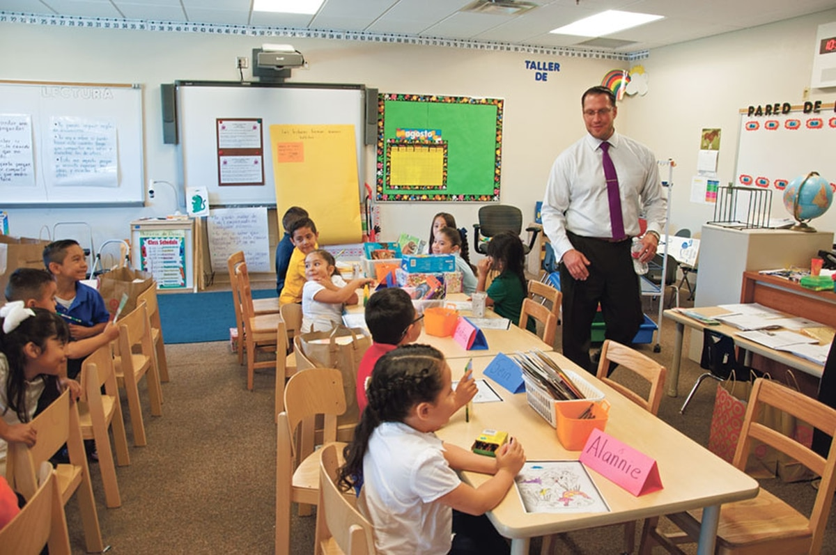 Superintendent Joel Boyd visits a bilingual classroom at Ramirez Thomas Elementary on the first day of school this year. He says the district knows dual-language models have the best outcomes for students.
