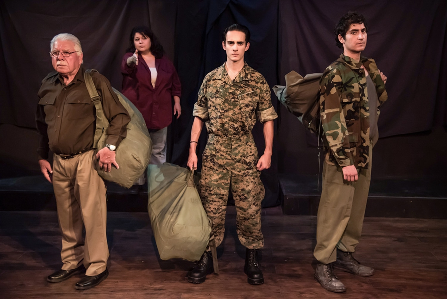 """From the Korean War, through Vietnam and into Iraq, the wartime legacy of the Ortiz family persists in Elliot: A Soldier's Fugue. (From left: Rudy """"Froggy"""" Fernandez, Juliet Salazar, Luca Pacheco and Niko'a Salas."""