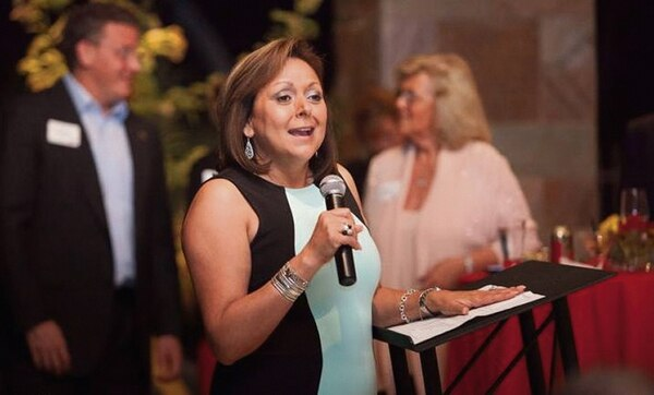 Susana Martinez speaks at 2013 fundraiser in Arizona attended by t he typical crowd that included an insurance industry executive and local business leaders.
