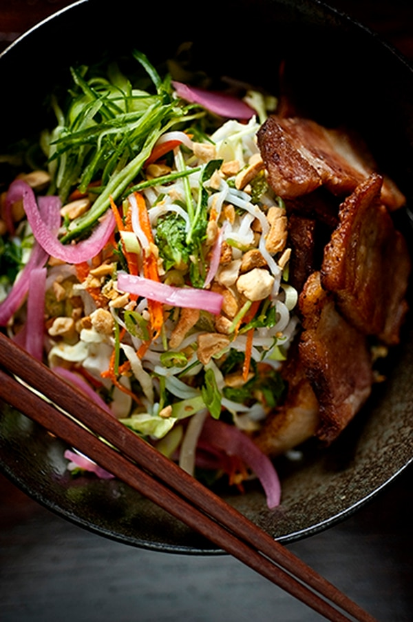 Vietnamese bun, rice noodles, pork belly and veggies with nuoc cham dressing with roasted peanuts