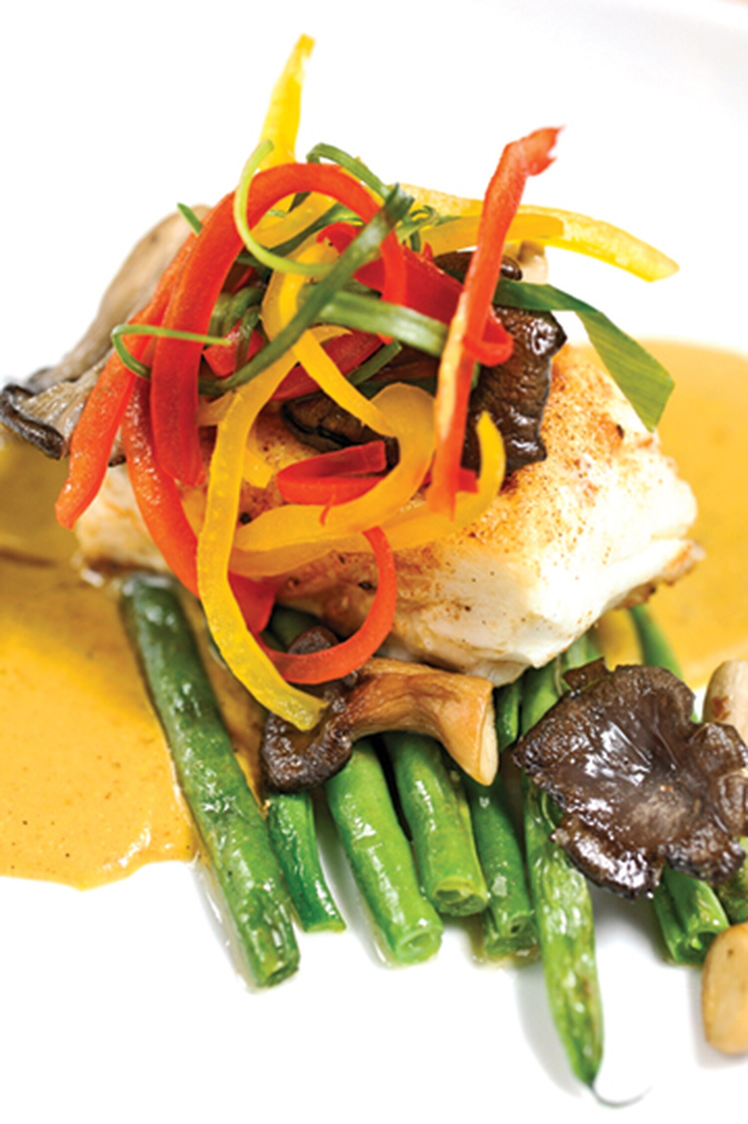 """Halibut en salsa de mole amarillo, with pan-seared halibut, sautéed oyster mushrooms, green beans, mango-yellow bell pepper and white chocolate mole. 125 Lincoln Ave., Ste. 117, 988-7102 Lunch and dinner daily Taberna Remember the last three times that you tried octopus? Forget them. Among the small plates at one of Santa Fe's original tapas joints is pulpo, braised octopus carpaccio with lemon juice, pimentón and olive oil ($13). The thin slices of fish get rid of the rubber-band memories and replace them with, """"Oh yeah, we ate that."""" Dependably terrific alcachofas, the artichokes wrapped in grilled jamón serrano with basil piñón pesto and goat cheese are all you really need in a vegetable ($15). Then, when your visit moves more in the dinner direction, we recommend the pair of tortita sliders made from braised short ribs with a sweet and tangy guava barbecue sauce and cabbage slaw ($12) and the tacos de robalo, generous helpings of fried barramundi with serrano peppers and all the fixings. On the side is a fire-hot habanero peanut sauce that will make your fancy port taste even more rich and decadent. Hit up this restaurant's outdoor seating, equipped with pole-mounted heaters to take maximum advantage of the bricked-in courtyard every season. -JAG"""