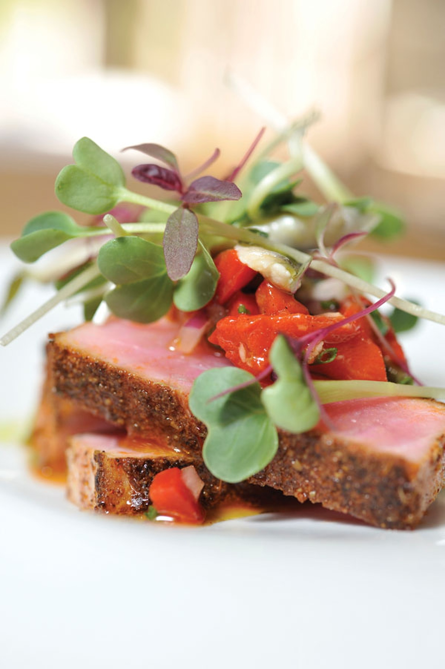 Spice-crusted tuna with pequillo pepper salsa and Turkish anchovies