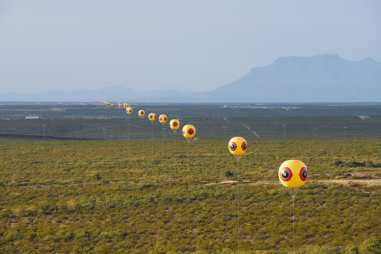 Repellent Fence was comprised of 26 balloons, each 10 feet in diameter, which flew 50 feet above the earth. The line stretched for two miles, from Douglas, Arizona, to Agua Prieta, Sonora, Mexico.