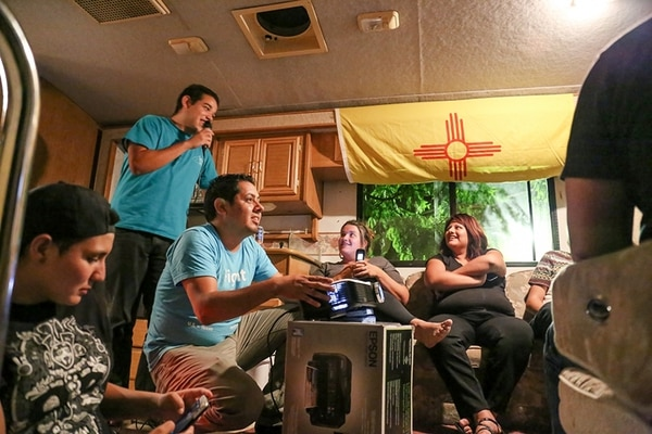 The Dreams on Wheels RV becomes a karaoke bar for a few hours after volunteers set up a room for legal clinic in Roswell.