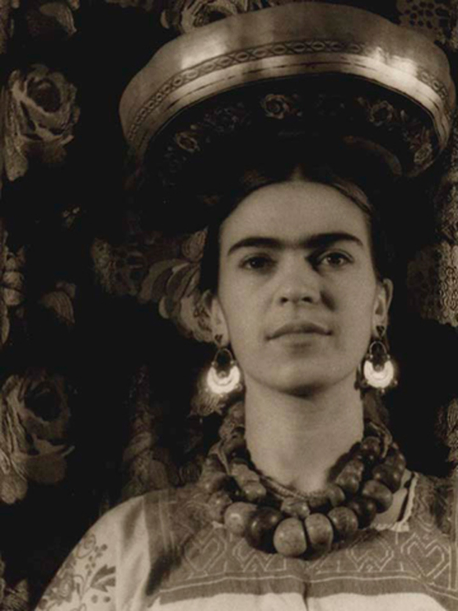 """Van Vechten's image of Kahlo, """"Frida with a Michoacán Gourd On Head,"""" was taken as Kahlo experimented with Mexican imagery."""