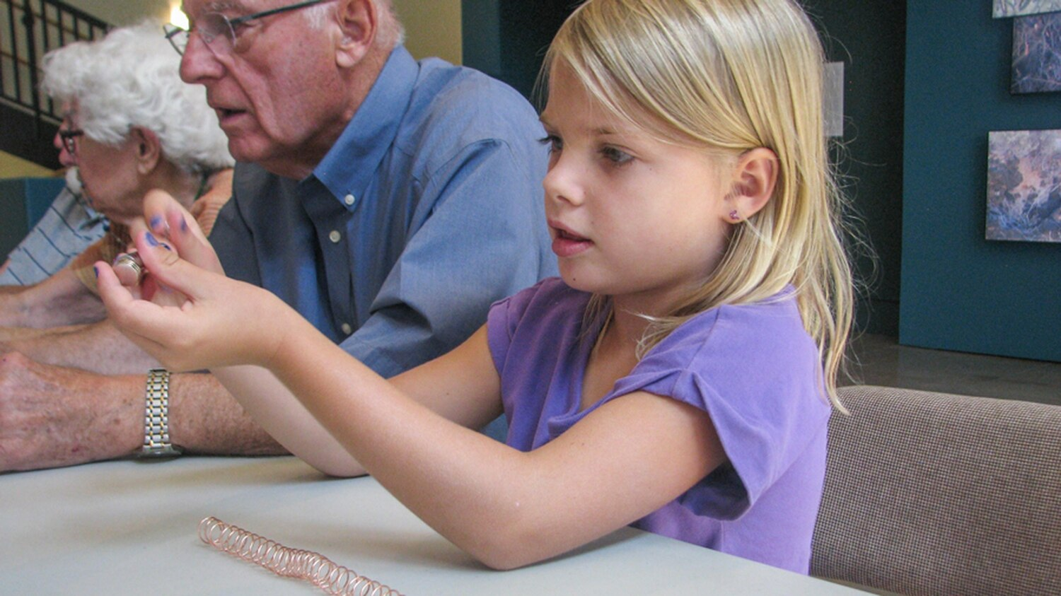 Riley Marks, age 6, and her grandfather Manny Marczak participated in an experiment to demonstrate magnetic levitation as part of the New Mexico History Museum's monthly Making History hands-on program.