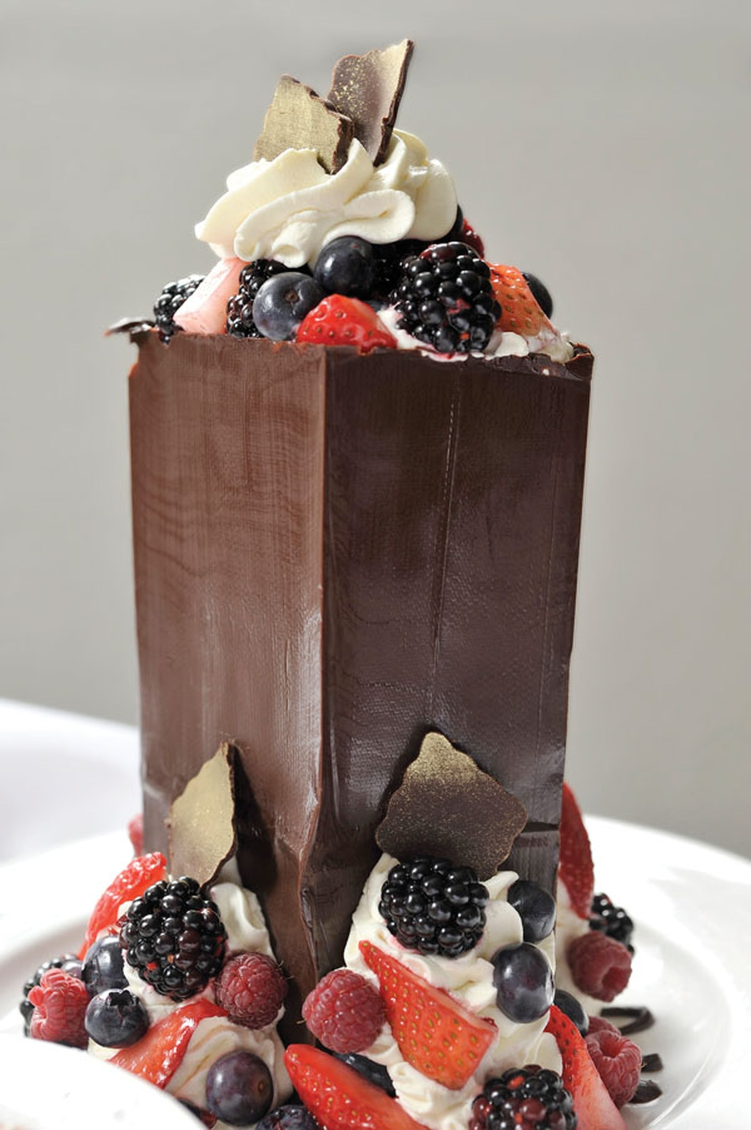 The Maven's Chocolate Sack, filled with berries, cake, caramel sauce and fresh whipped cream