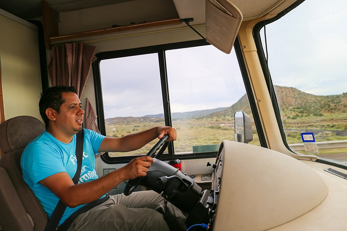 Community organizer Hector Aveldaño pilots the 34-foot RV to rural New Mexico.