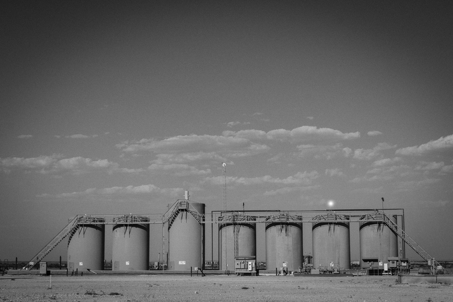 Petroleum and produced water storage tanks in the Permian Basin south of Lovington, New Mexico.