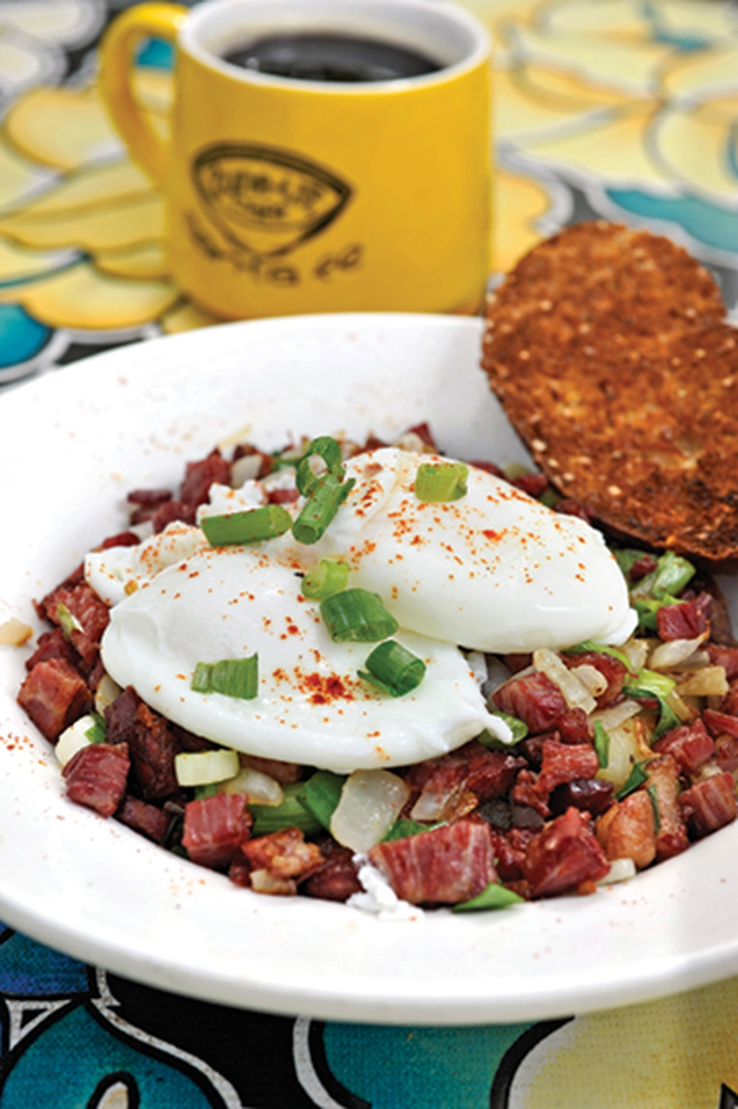 """Corned beef hash with housemade corned beef, two poached eggs and toast. 1115 Hickox St., 983-7060 Breakfast, lunch and dinner daily Tune-Up Café If you want take a date out for a decent meal and appear local at the same time, try the Tune-Up Cafe. It's a neighborhood bar whose range in cuisine is hard to exactly define but definitely Latino at its core. Is it a Mexican bistro? Is it an Italian eatery? Charlotte Rivera says she'd prefer not to pigeonhole and adds that everything is awesome. For sure, a few of the courses are funky sounding, like the """"Eggs in hell"""" ($10.95), a pair of poached eggs in homemade pomodoro sauce with crushed red peppers, spinach, Parmesan cheese, hash browns and ciabatta toast (crusty on the outside and soft on the inside). Or try the lamb barbacoa tacos ($11.95). They've got to be the best corn-tortilla tacos in town with cotija cheese, spinach, radish, onion, cilantro, refried beans, Spanish rice and árbol tomatillo sauce. The fresh squeezed cantaloupe and/or watermelon ($2) are also a nutritious alternative to orange juice. And it's spooned out of a big container that makes you feel like you're south of the border. -TR"""