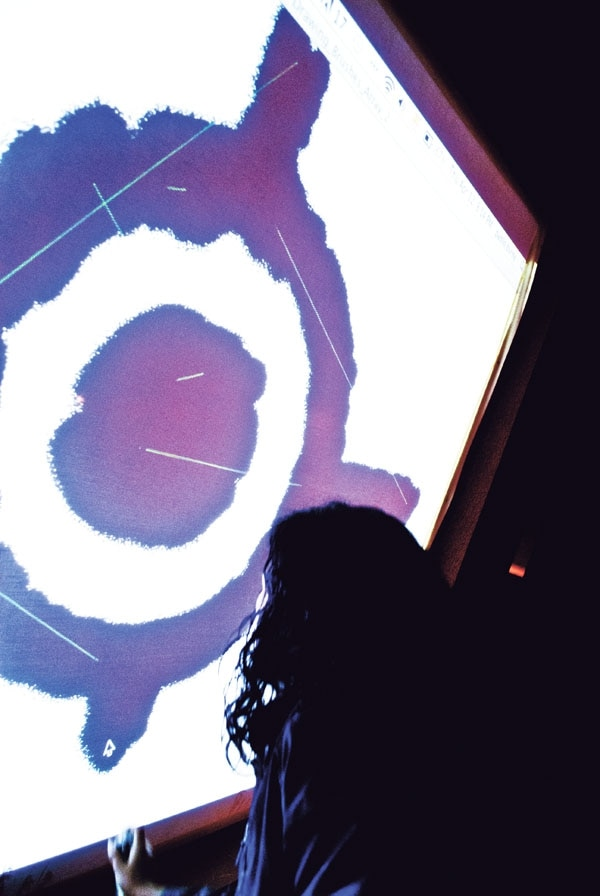 Pablo Byrne and Miguel Martinez Cano's interactive installation allows participants to digitally spray-paint onto a screen using an infrared light and a Wii-mote. The Wii-mote sees the infrared light and sends its position to the computer, which renders the spray-paint effect.