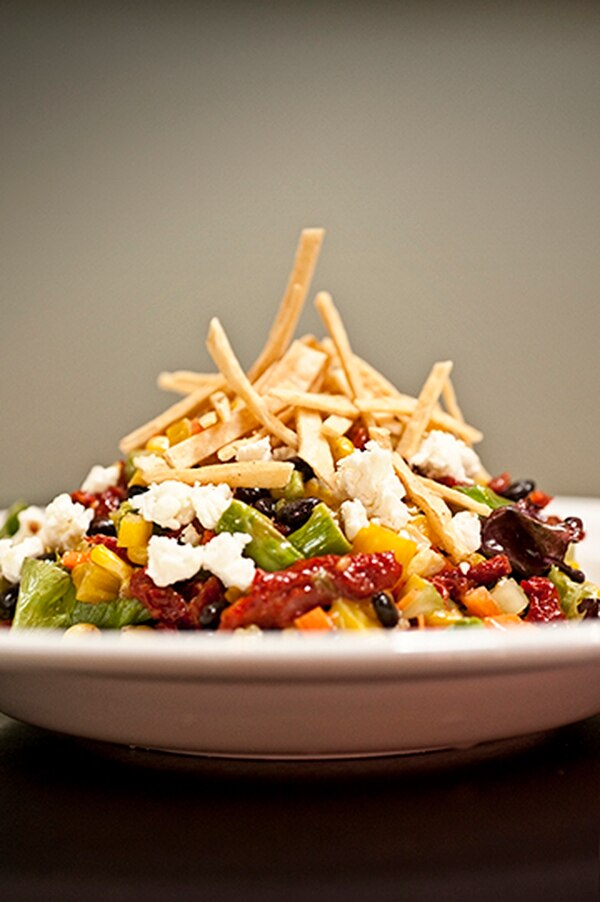 Chopped veggie salad with beets, asparagus, sun dried tomatoes, black beans, fresh corn, goat cheese and tortilla strips