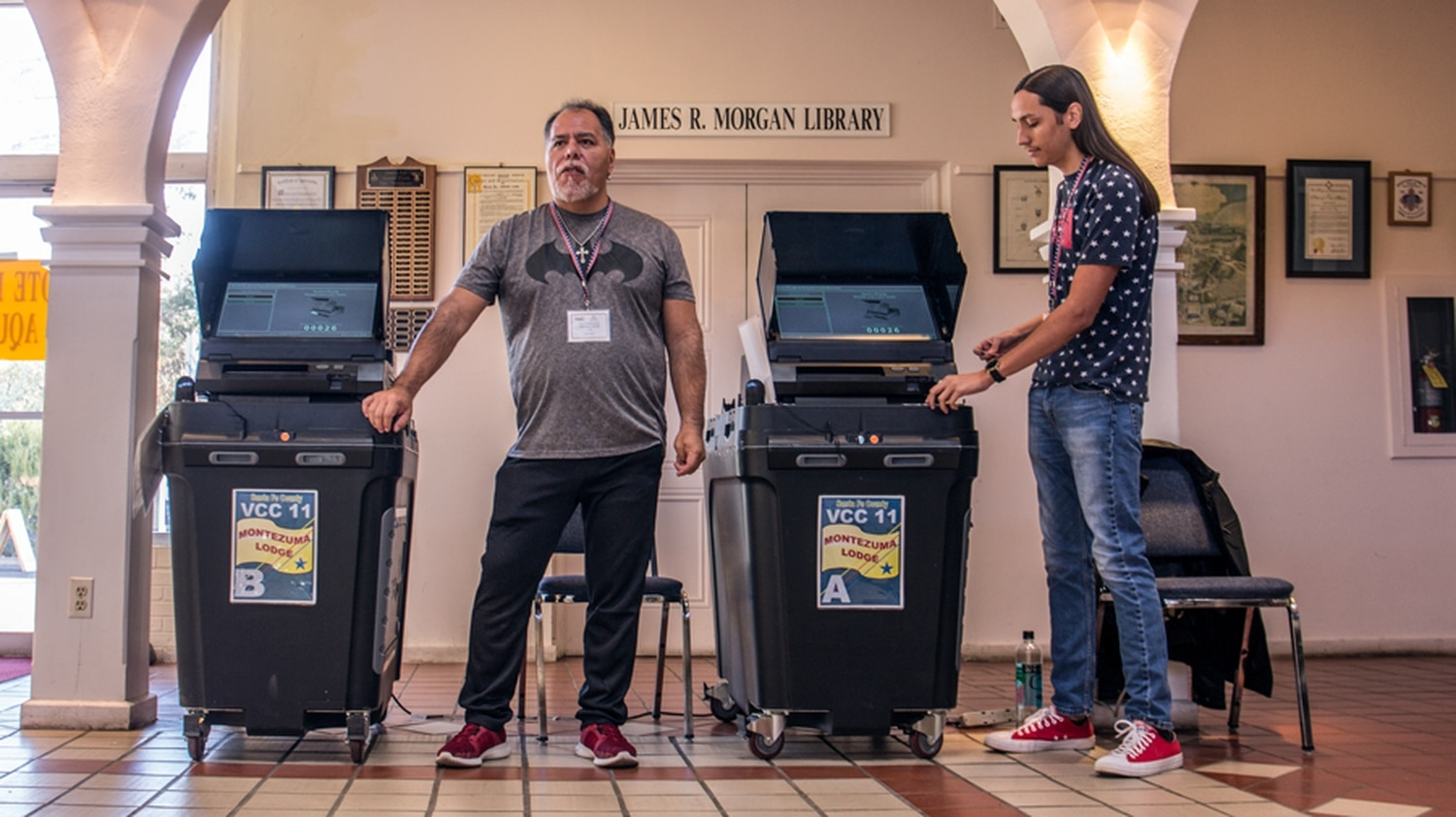 Poll workers and voting machines at the Montezuma Lodge downtown.