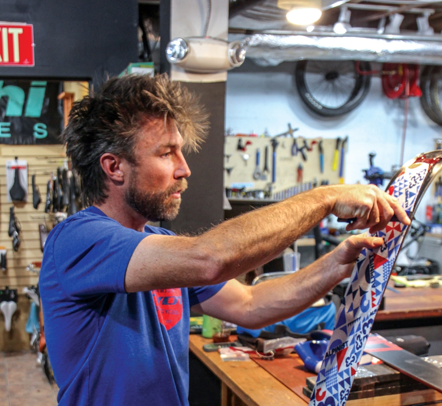 Owen Haggard says the key to trimming skins is a smooth, confident cut that leaves enough of the ski bottom exposed to grab an edge.