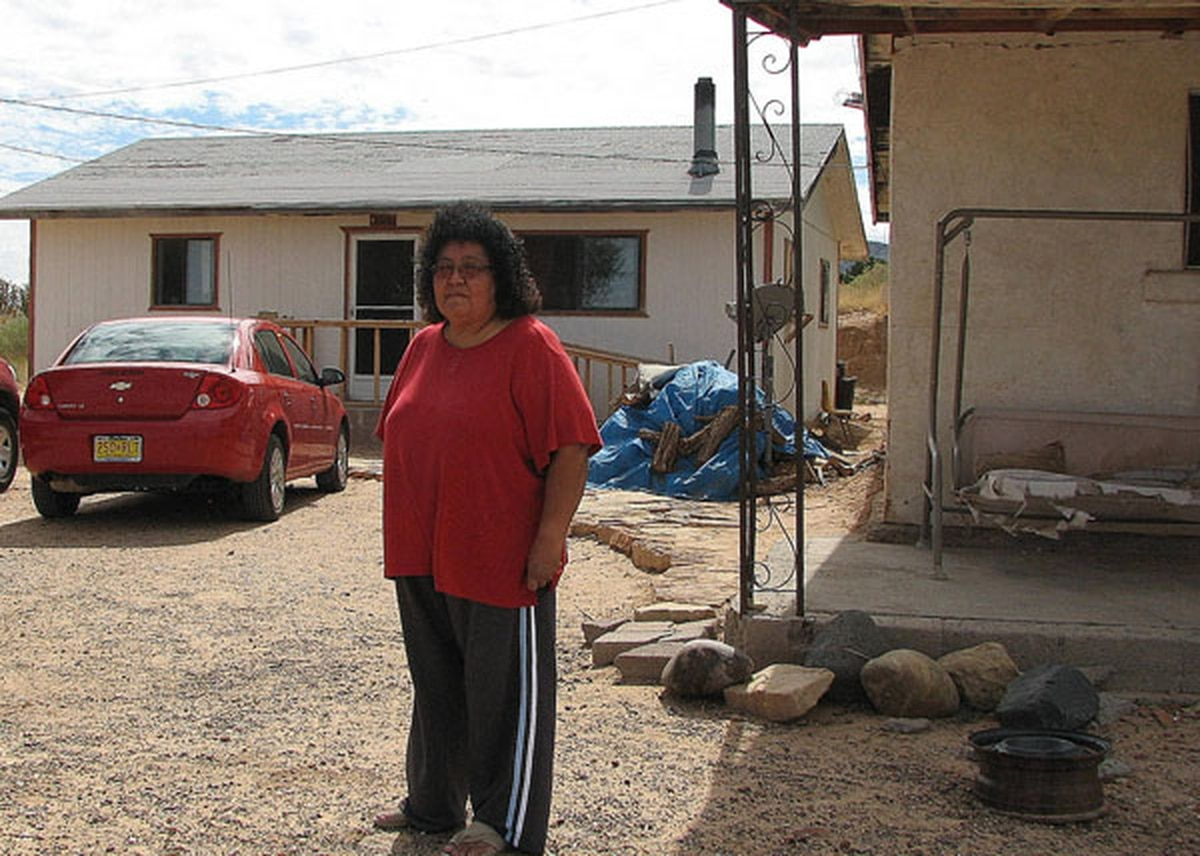 Rebekah Apachito stands outside her home in To'hajiilee, a Navajo community 90 miles west of Santa Fe, where rampant violence and a flawed justice system have created what Apachito describes as a profoundly unsafe environment.
