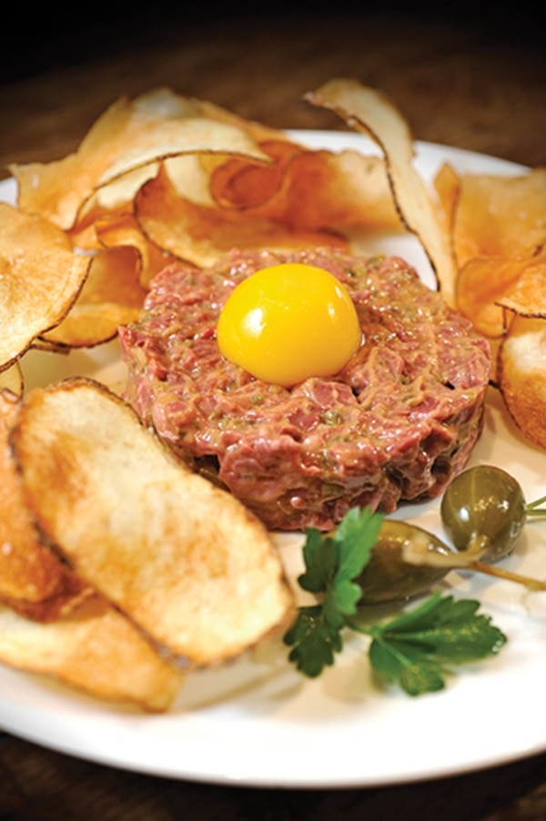 Tenderloin steak tartare, fresh farm eggs and house potato chips. 451 W Alameda St., 982-6297 Dinner Tuesday-Saturday Bouche Bouche feels like a place worth coming home to stay. Pull up a seat on their patio to enjoy dinner with a sunset-strewn sky over the top of their walled garden, or take a table indoors, among the hardwood floors and fireplace that recall a country coziness without overstating the point. Chef Charles Dale strolls the tables to check in on those enjoying a flawless and approachable menu. Make no mistake—while the wine list may be four pages (and wait staff happy to counsel you through those difficult choices) and the dinner menu a quarter-page, the emphasis is on well-considered food that draws from local and sustainable choices and the very best of French cuisine. Approachably casual black mussels in white wine and red chile sauce ($16/$26) are worth their weight in tiny forks—and, naturally, sneaking a dip of the housemade bread into. A mountain of truffle frites ($7/$9) dense with umami makes good company. Finish off with crème brûlée or the tart of the evening, which on our visit was built around all the natural sweetness of Colorado peaches. -EM