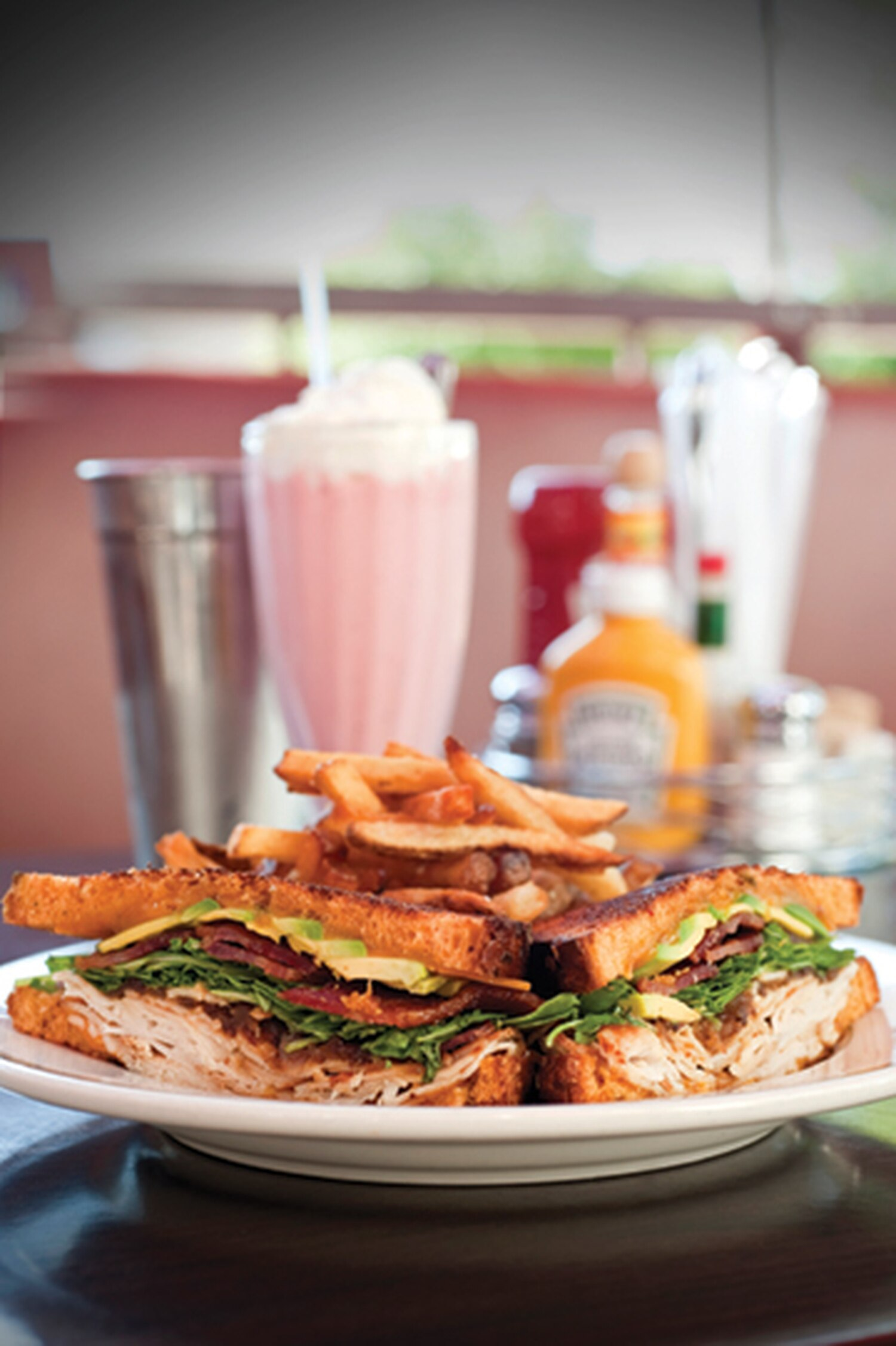 Turkey melt with strawberry shake. 3466 Zafarano Drive, 424-0755 Breakfast, lunch and dinner daily Plaza Café Southside While the Plaza Café downtown may recall the City Different's Greek roots, its Southside compatriot feels more firmly planted in the charms of another era—a chrome-plated, neon-lit, milk-shaking era. The Plaza Café Southside fuels indulgences in the classic pleasures of a hamburger and French fries ($11.95) or 8-ounce grass-fed rib-eye steak and cheese enchiladas ($21). Wander off the beaten (and beef-driven) track to try the crispy avocado tacos ($12.95), avocado encrusted with crunchy quinoa, sesame and poppy seeds topped with a colorful splash of pickled onion, cilantro, corn and red pepper and accompanied by a trio of salsas, the smoky red salsa matching particularly well. Round your meal out with a slice of caramel apple pie ($6.45), or get a little adventurous and go for the red velvet flan ($6.45), a dense layer of red velvet cake with creamy flan on top, a melt-in-your-mouth, expletive-inducing combination. Enjoy it all inside, amid the vinyl and chrome, or take it outside onto a pleasantly shaded patio on the San Isidro Plaza, facing the Regal Stadium 14. -EM