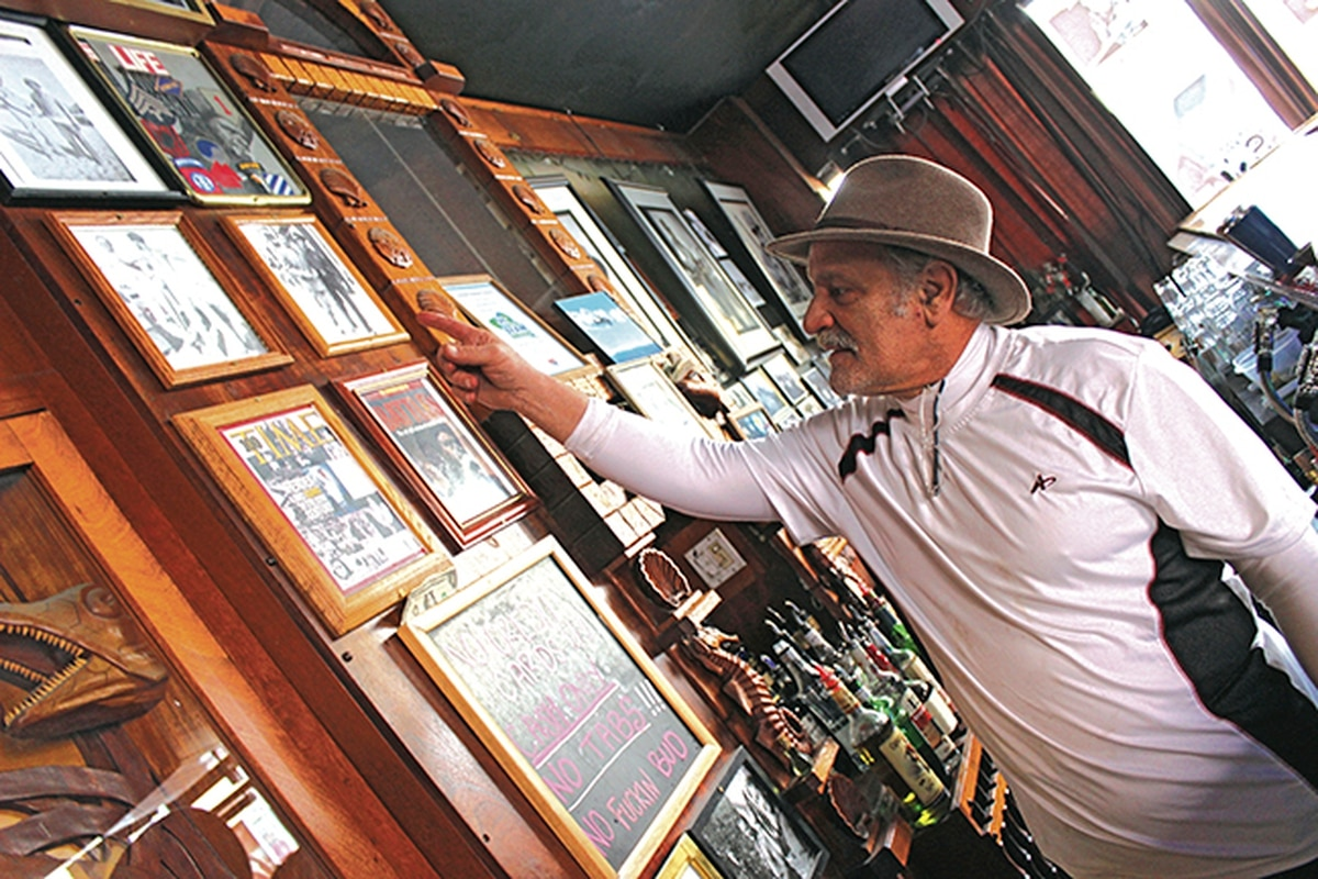 Evangelo's bar serves as a photography gallery that Nick Klonis uses to illustrate storytelling.