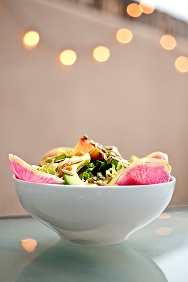 Peach and avocado salad with watermelon radish, cilantro vinaigrette and pumpkin seeds