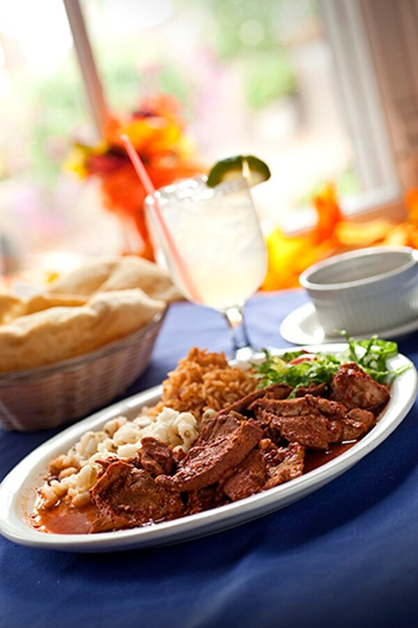Carne adovada with marinated pork cooked in a spicy red chile caribe sauce with rice and posole; house margarita