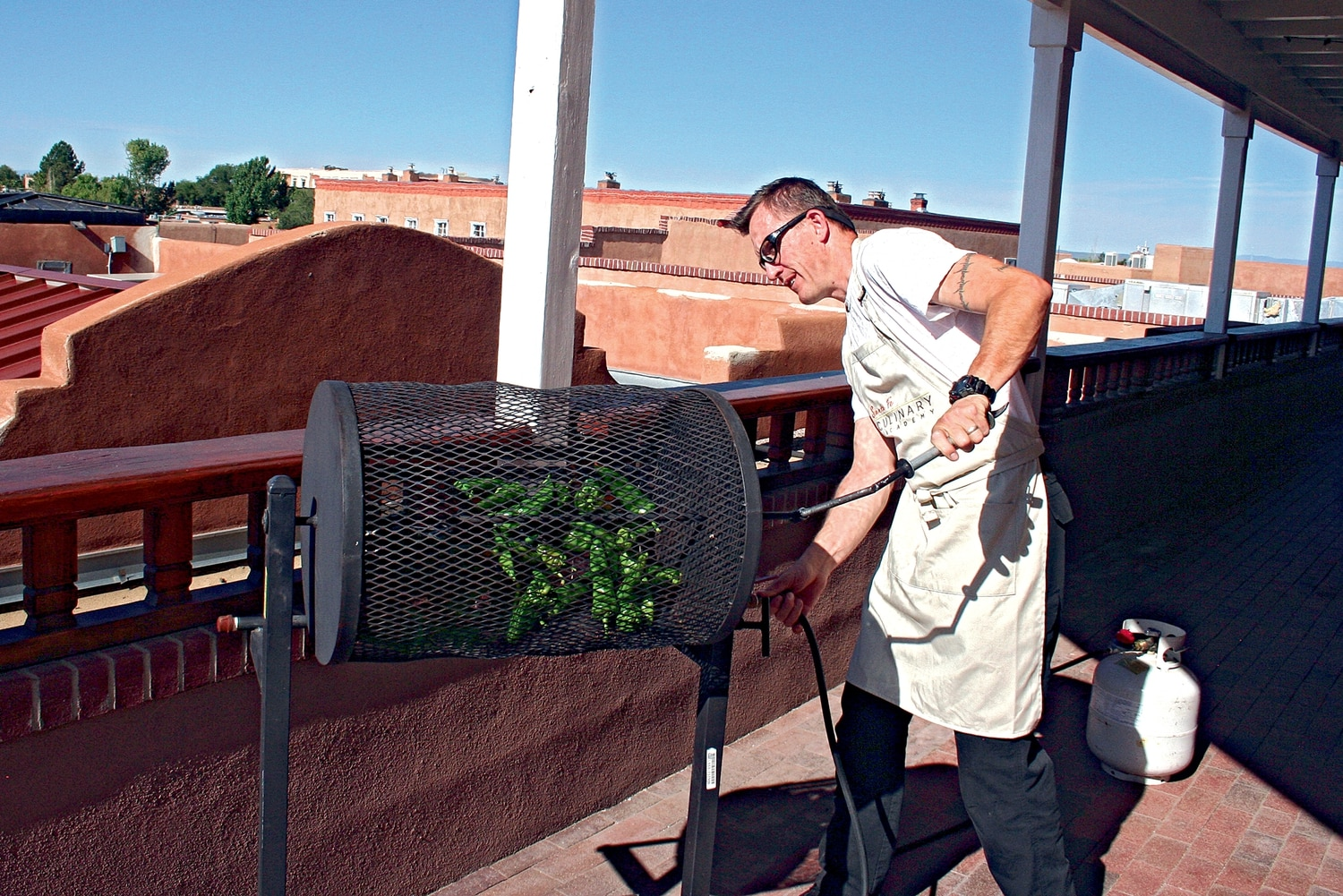 Santa Fe Culinary Academy chef and co-founder Rocky Durham blazes up some of his favorite chile, Romero Farms' Alcalde Improved, on the SFCA balcony.