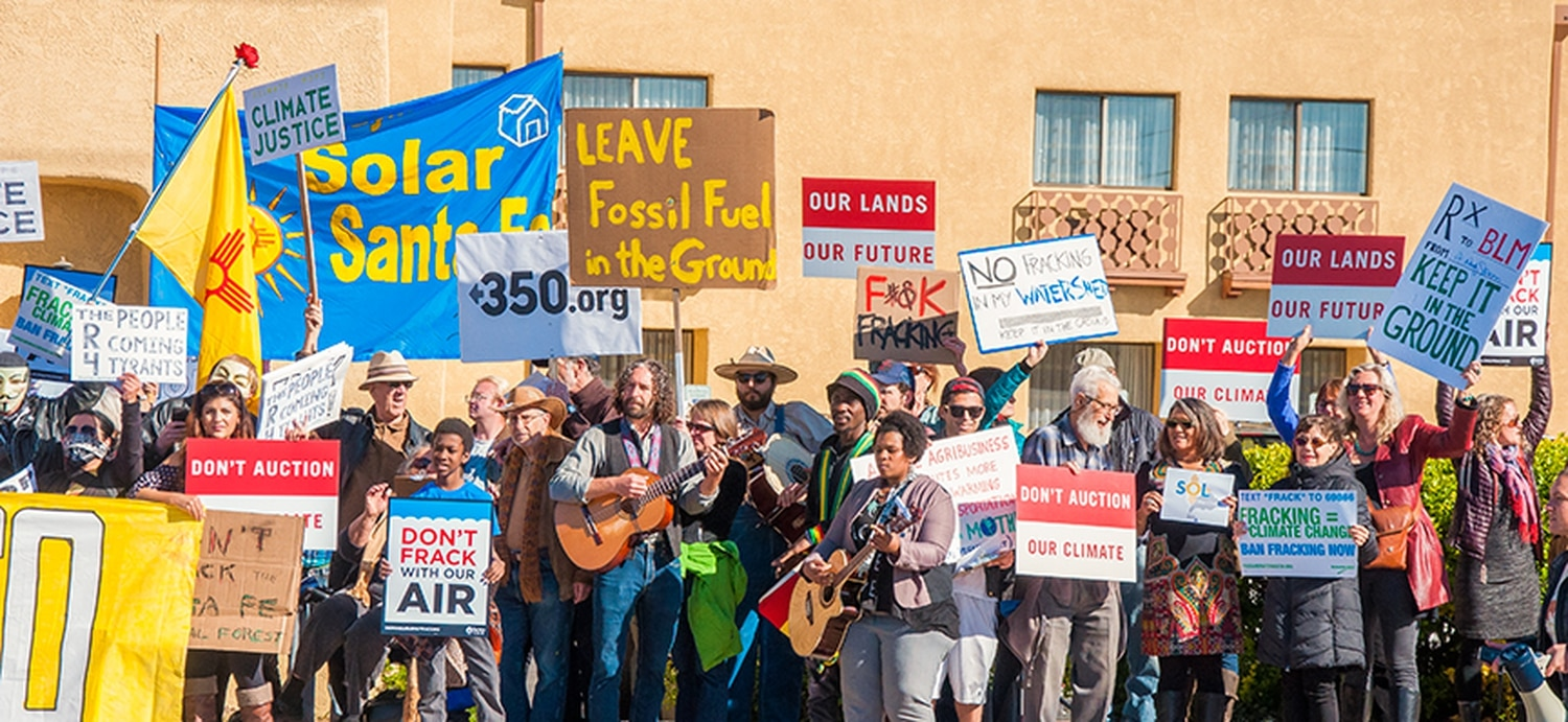 Protesters lined Cerrillos Road during a BLM auction in April.