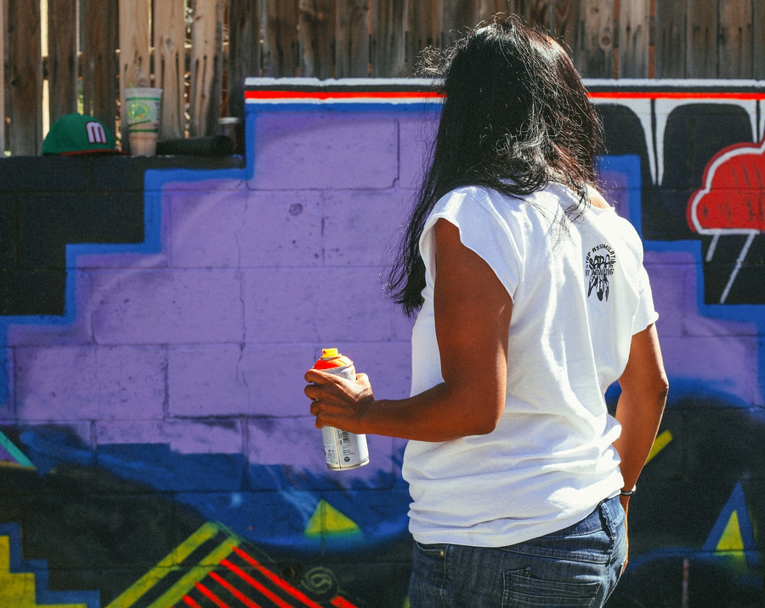 Christina Castro of the Three Sisters Collective prepares to start painting again.