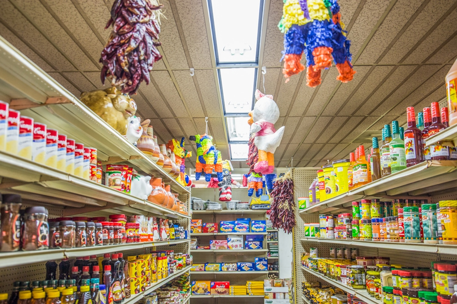 The shelves at stores like El Paisano are stocked with groceries, novelties, and even haircare and medicine from south of here.