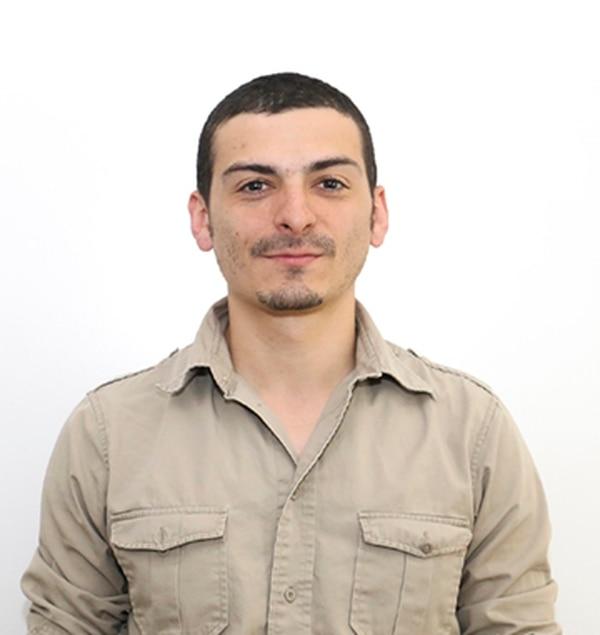 Aaron Cantú's press credential photo.
