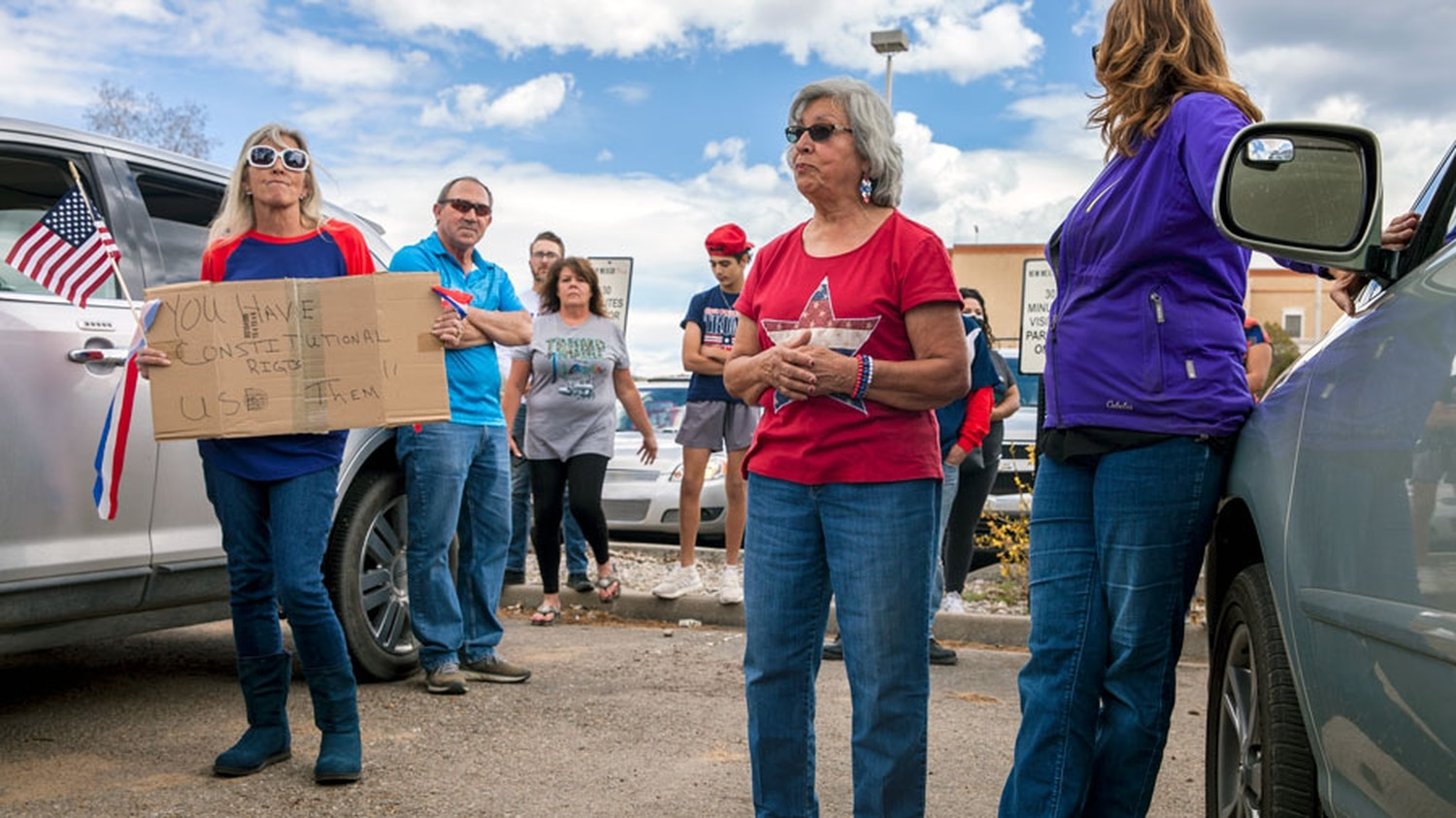 (From left to right) Terri Chrisman, Marcella Melendez and Debra Gowen mingle outside of their vehicles after the protest.