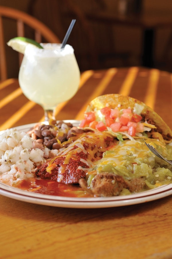 AtrisCombo: relleno with green chile, blue corn chicken enchilada with red chile, beef taco, posole and beans