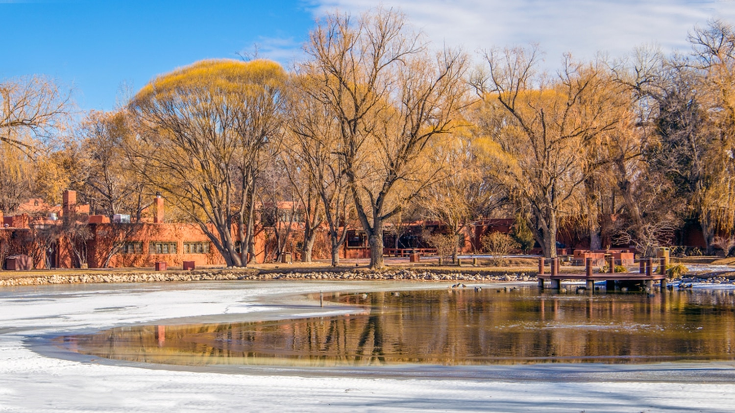 The residential units at Delancey Street Ranch look out on the peaceful setting of Swan Lake. The ranch caters weddings here during summer.