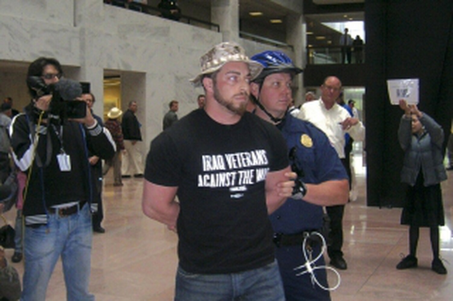 Adam Kokesh is led away from the Senate Hart Office Building after protest in 2007.Carol Moore