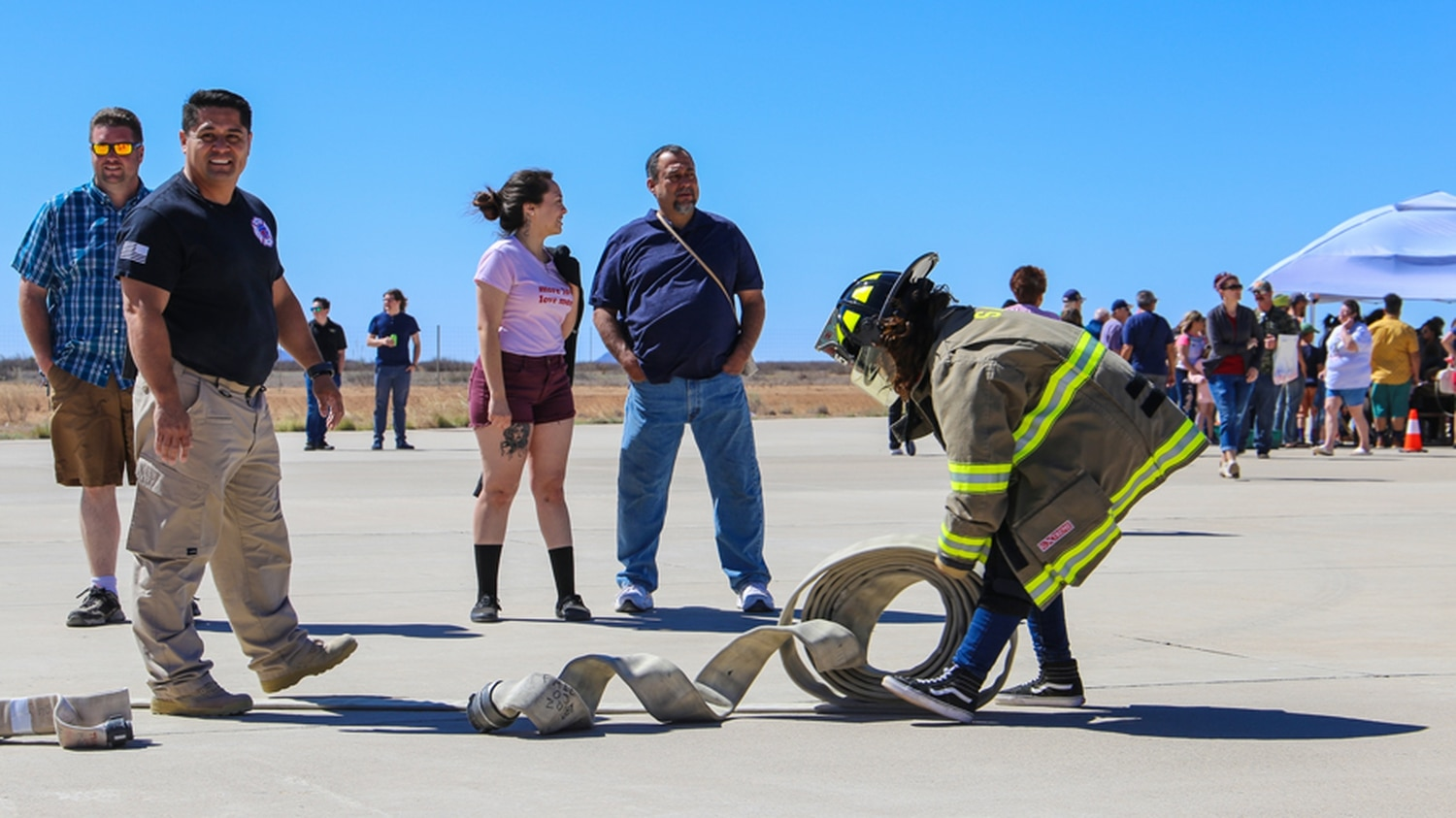 Child rolls out firehose at Space Festival