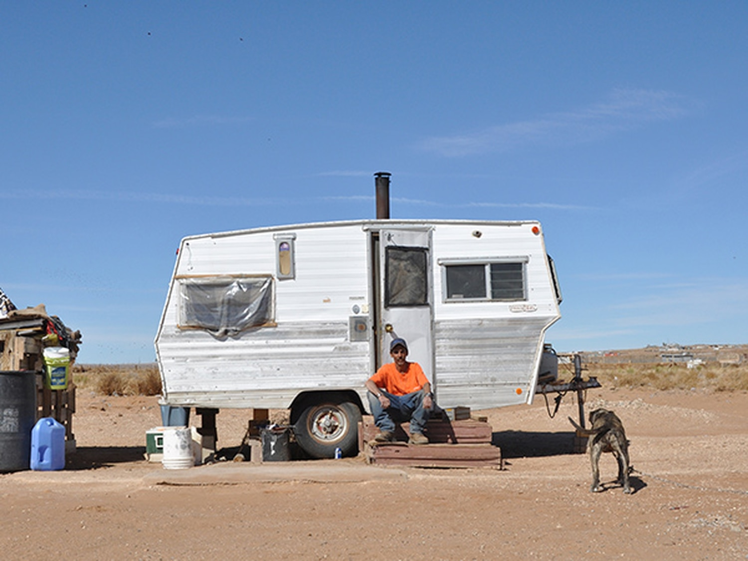 Victor Armijo sitting in front of his trailer.
