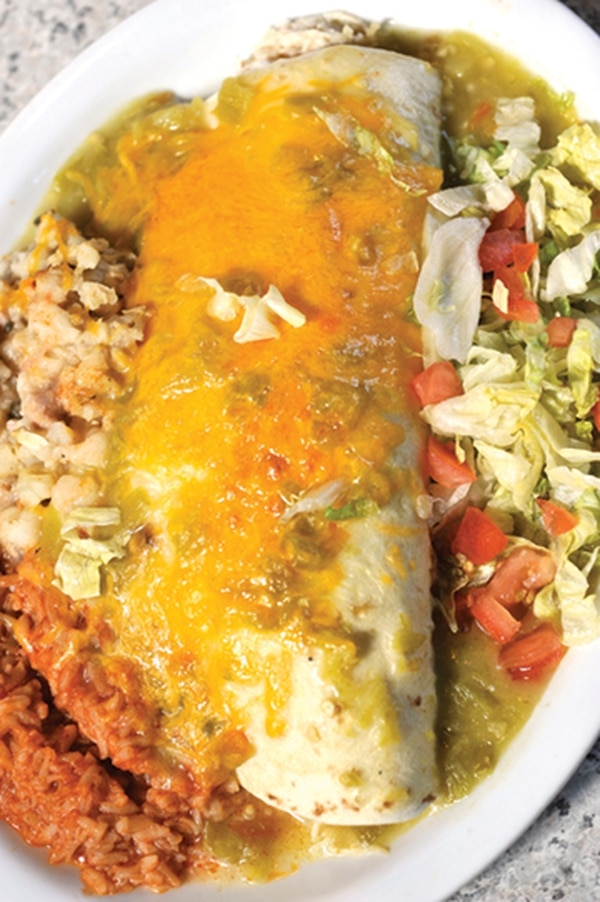 "Green chile chicken burrito. 4354 Cerrillos Road, 471-5420 Breakfast lunch and dinner Monday-Saturday; Breakfast and lunch Sunday Horseman's Haven Sharing its real estate with a gas station, the Haven is where you come to fill yourself up with some of the most delectable home-style dishes around and green chile hotter than Satan's discharge. Take your pick from the menu, the Romeros have you covered. Be it with an incomparable chorizo breakfast ($9.25), chicken-stuffed quesadillas ($9.95), ""Mucho burgers"" ($6.25 and up) and an in-house specialty, the 3-D ground beef burrito ($8.95). On a recent visit, I opted for the carne adovada and eggs ($10.50)—two eggs over easy, home fries, a big ol' serving of just-right carne adovada and a warm flour tortilla. The carne was perfectly braised and soupy. It joined forces with the runny egg yolks and those potatoes were quickly surrounded. I came in with a torn-off piece of tortilla, but they never stood a chance. -EL"
