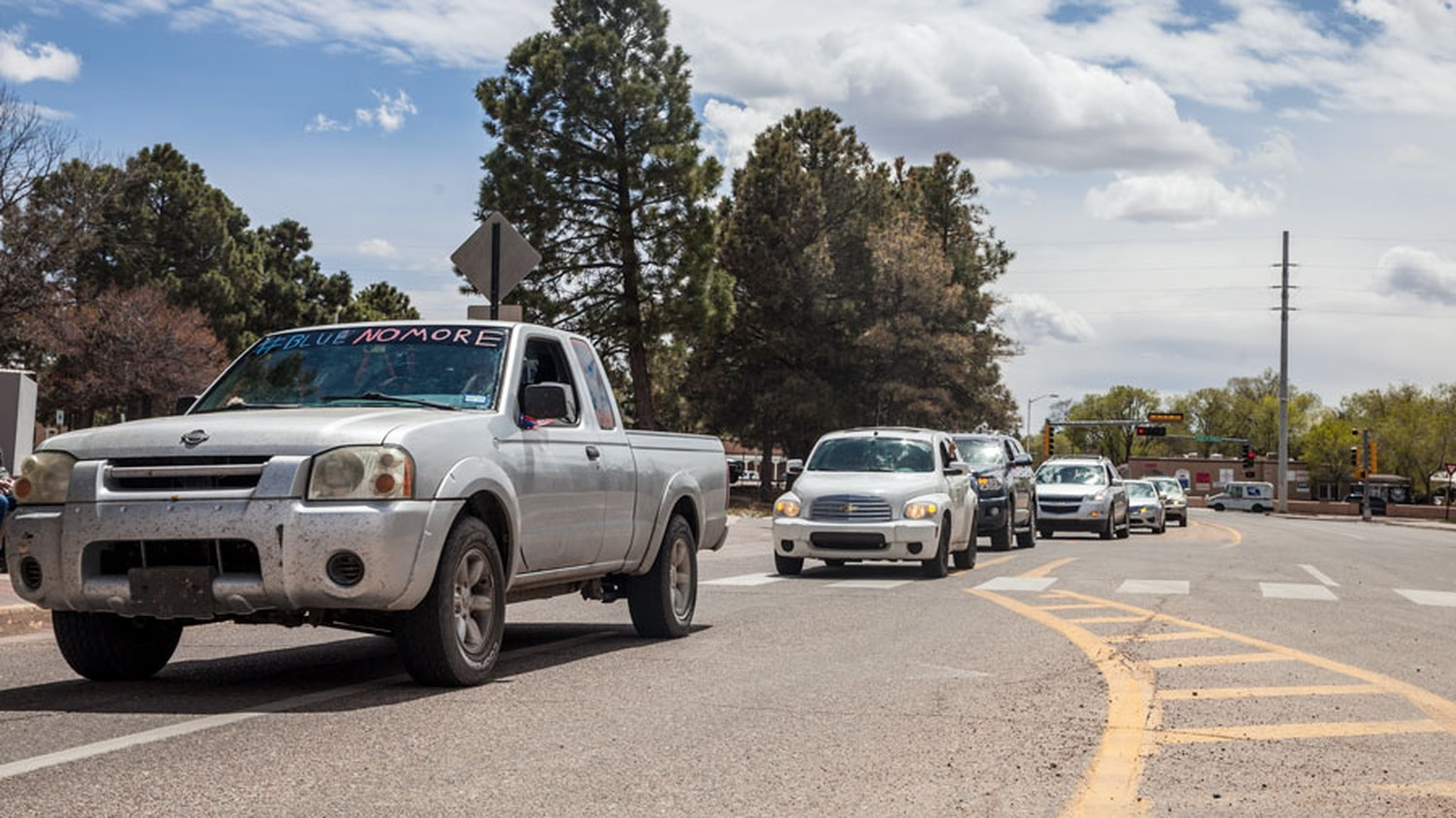 Around a dozen cars circled the Capitol honking on Monday.
