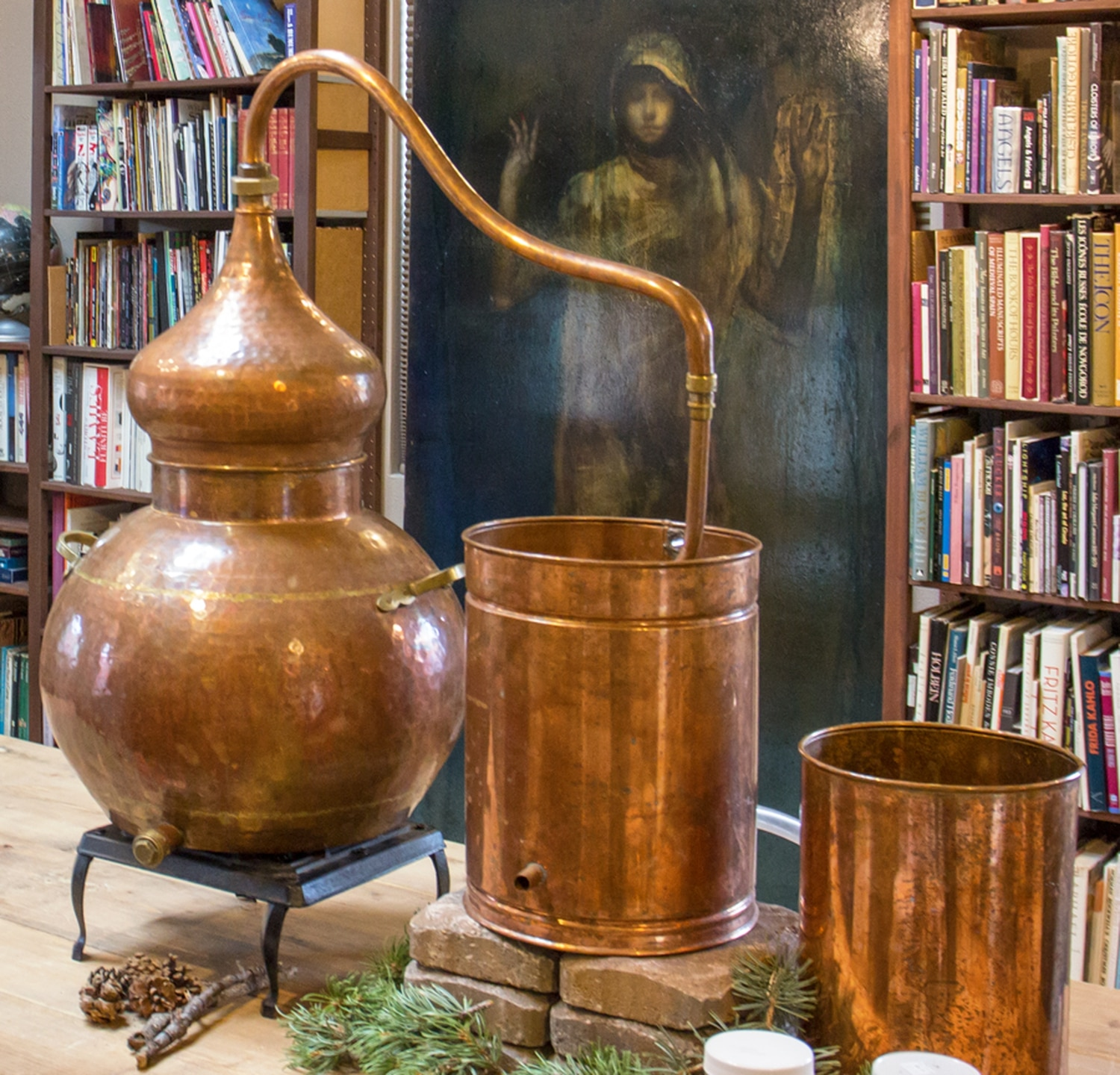 Villa recently distilled local piñon pine resin using this copper still.
