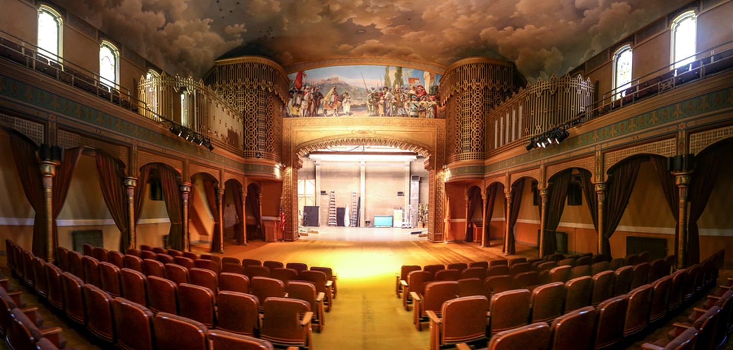 The theater inside the Scottish Rite Masonic Center includes a pipe organ and painted ceiling.